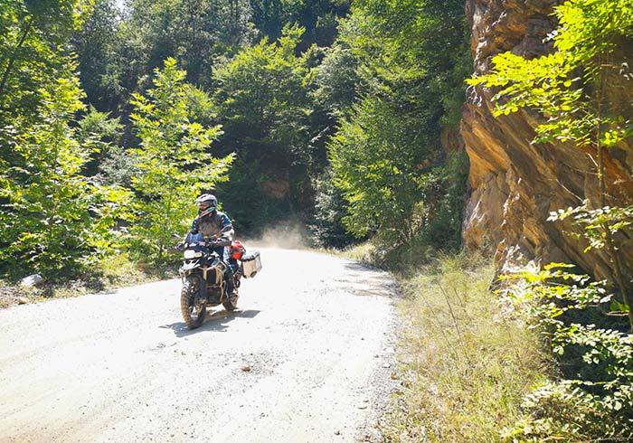 Motorcycling along the banks of Lake Pangong